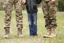 bigstock-Military-family-reunited-on-a-169768235